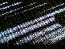 Modelo de la luz del sol y de la luz y oscuridad en piso verde de la manta Imagenes de archivo