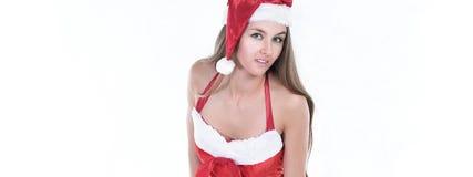 Modelo de la mujer joven en un traje de la Navidad que presenta para la cámara Imágenes de archivo libres de regalías