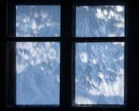 Modelo de la nieve en la ventana Fotografía de archivo libre de regalías