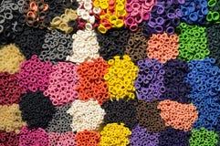 Modelo de las bocas coloridas del globo del látex organizadas por colores como Imagen de archivo