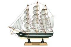 Modelo de madeira do veleiro do navio em um fundo branco Imagem de Stock