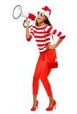 Modelo de moda atractivo en sombrero rojo de la Navidad que lleva Imagen de archivo