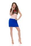 Modelo de moda de grito In Mini Dress And High Heels Imágenes de archivo libres de regalías