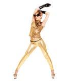 Modelo de moda en traje de oro Fotos de archivo libres de regalías