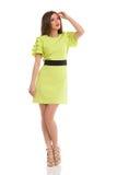 Modelo de moda In Lime Green Mini Dress And High Heels fotografía de archivo libre de regalías