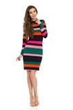 Modelo de moda In Striped Vibrant Mini Dress And High Heels Fotografía de archivo libre de regalías