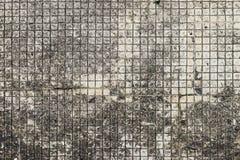 Modelo de mosaico envejecido del grunge con la textura gris útil para el fondo, los papeles pintados o el espacio de la copia par fotos de archivo libres de regalías