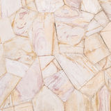 Modelo de piedra superficial del primer del fondo de piedra marrón de la textura de la pared de ladrillos en tono del vintage Imagen de archivo libre de regalías