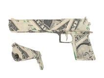 Modelo de un arma hecho por las cuentas de dólar Fotografía de archivo libre de regalías