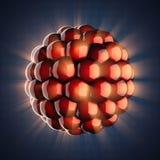 Modelo del átomo en fondo azul Fotos de archivo libres de regalías