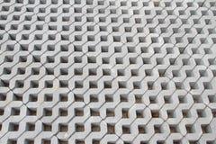 Modelo del bloque del cemento en el piso Imagenes de archivo