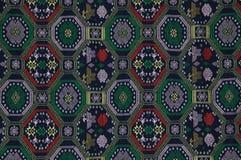 Modelo del bordado del estilo chino de la minoría Fotos de archivo
