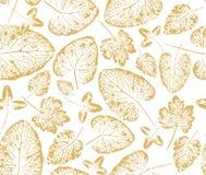 Modelo del papel de embalaje con las impresiones de las hojas del oro Fotos de archivo libres de regalías