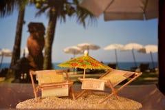 Modelo del parasole y de los sunbeds Imagen de archivo libre de regalías