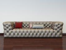 Modelo del sofá en interior Foto de archivo libre de regalías