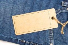 Modelo do preço da etiqueta na calças de ganga Foto de Stock