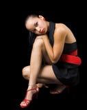 Modelo em preto e no vermelho Fotos de Stock Royalty Free