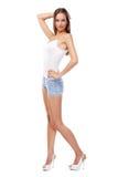 Modelo femenino hermoso joven en el fondo blanco Foto de archivo