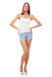 Modelo femenino hermoso joven en el fondo blanco Fotos de archivo