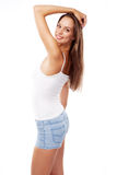 Modelo femenino hermoso joven en el fondo blanco Foto de archivo libre de regalías