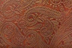 Modelo floral en cuero marrón Imágenes de archivo libres de regalías