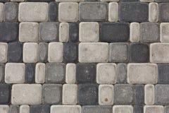 Modelo gris de la textura de la piedra áspera en el camino Fotografía de archivo