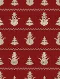 Modelo hecho punto inconsútil con los árboles de navidad y los muñecos de nieve en un fondo rojo ilustración del vector