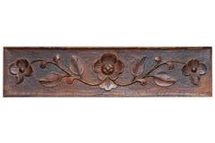 Modelo hermoso bajo la forma de flores y hojas en un tablón de madera carving imagen de archivo