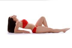 Modelo hermoso en traje de baño rojo Imagenes de archivo