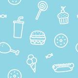 Modelo inconsútil azul de Junk Food Imágenes de archivo libres de regalías