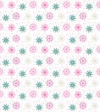 Modelo inconsútil colorido de muchos copos de nieve en el fondo blanco Foto de archivo libre de regalías