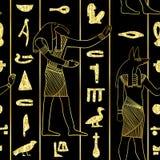 Modelo inconsútil con dioses egipcios y jeroglíficos egipcios antiguos con textura de oro de la hoja del brillo stock de ilustración