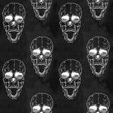 Modelo inconsútil con el cráneo en fondo del grunge Foto de archivo