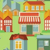 Modelo inconsútil con las casas de la historieta Imagen de archivo libre de regalías