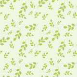 Modelo inconsútil con las hojas colocadas aleatoriamente en fondo verde claro Foto de archivo