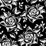 Modelo inconsútil con las siluetas blancas de rosas en negro. Foto de archivo