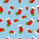 Modelo inconsútil con los calcetines de la Navidad Ilustración del vector libre illustration