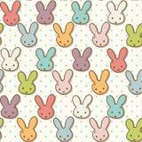 Modelo inconsútil con los conejos lindos Fondo colorido del conejito ilustración del vector