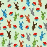 Modelo inconsútil con los conejos y las bolas Imagen de archivo