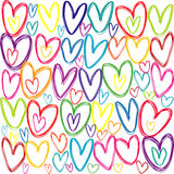 Modelo inconsútil con los corazones coloreados del garabato Foto de archivo libre de regalías
