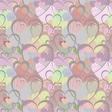 Modelo inconsútil con los corazones marrones en el fondo de corazones en diversos colores Fotografía de archivo libre de regalías