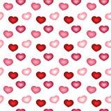 Modelo inconsútil con los corazones rosados y rojos Imagen de archivo