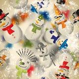 Modelo inconsútil con los muñecos de nieve con el contexto borroso en vintage Fotografía de archivo libre de regalías