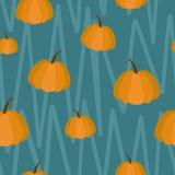 Modelo inconsútil de calabazas anaranjadas en fondo azul stock de ilustración