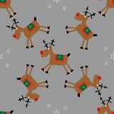 Modelo inconsútil de la Feliz Navidad con los ciervos y los copos de nieve del trasero imágenes de archivo libres de regalías