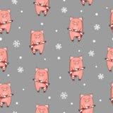 Modelo inconsútil de la Navidad con el cerdo lindo de la historieta con el bastón de caramelo de Navidad imagen de archivo