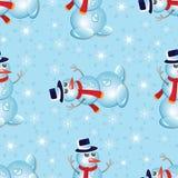 Modelo inconsútil de la Navidad con el muñeco de nieve y los copos de nieve Imagen de archivo