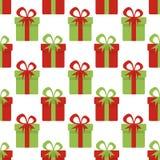 Modelo inconsútil de la Navidad con las cajas de regalo rojas y verdes La Navidad Texturas para el papel pintado, página web Fotografía de archivo