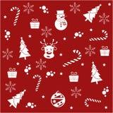 Modelo inconsútil de la Navidad en fondo rojo imagenes de archivo
