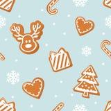 Modelo inconsútil de la Navidad Galletas y copos de nieve del pan de jengibre en azul en colores pastel Fotos de archivo